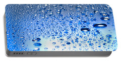 Water Drops On A Shiny Surface Portable Battery Charger