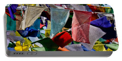 Portable Battery Charger featuring the photograph Waving Prayer Flags by Don Schwartz