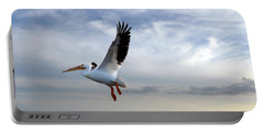 Portable Battery Charger featuring the photograph White Pelican Flying Over Island by Dan Friend