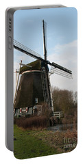 Portable Battery Charger featuring the digital art Windmill In Amsterdam by Carol Ailles