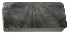 Portable Battery Charger featuring the photograph Winter Tracks  by Neal Eslinger