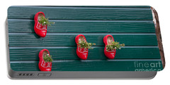 Portable Battery Charger featuring the digital art Wooden Shoes On Teh Wall by Carol Ailles