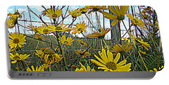 Portable Battery Charger featuring the photograph Yellow Flowers By The Roadside by Alice Gipson