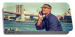 African American Man Traveling In New York Portable Battery Charger