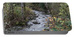 Portable Battery Charger featuring the photograph An Autumn Stream by Jeff Swan