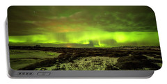 Aurora Borealis Over A Frozen Lake Portable Battery Charger by Joe Belanger