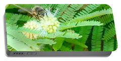 Bee Happy Portable Battery Charger by Russell Keating