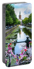 Portable Battery Charger featuring the digital art Canal And Decorated Bike In The Hague by RicardMN Photography