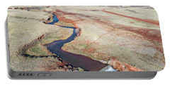 creek at  Colorado foothills - aerial view Portable Battery Charger