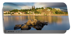 Famous Vysehrad Church During Sunny Day. Amazing Cloudy Sky In Motion. Vltava River, Prague, Czech Republic Portable Battery Charger