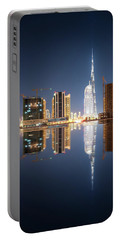 Fascinating Reflection Of Tallest Skyscrapers In Business Bay District During Calm Night. Dubai, United Arab Emirates. Portable Battery Charger