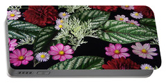 Portable Battery Charger featuring the photograph Floating Flower Bouquet by Byron Varvarigos