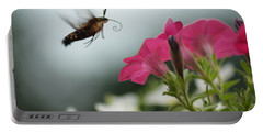 Portable Battery Charger featuring the photograph Hummer Moth by Heidi Poulin
