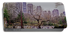 Portable Battery Charger featuring the photograph Ice Skaters On Wollman Rink by Sandy Moulder
