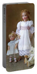 Portable Battery Charger featuring the photograph Kindhearted Kish Dolls by Nancy Lee Moran