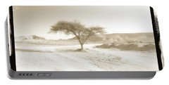 Portable Battery Charger featuring the photograph Lonely Tree by Arik Baltinester