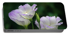 Portable Battery Charger featuring the photograph Lovely Lisianthus by Byron Varvarigos