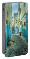 Man In White Djellaba Walking In Medina Of Rabat Portable Battery Charger
