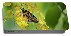 Monarch Butterfly On Yellow Orchids Portable Battery Charger