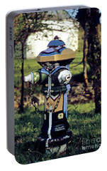 Portable Battery Charger featuring the photograph Oldenburg Fireplug by Gary Wonning