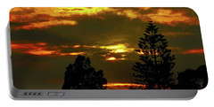 Portable Battery Charger featuring the photograph Ominous Sunset by Mark Blauhoefer