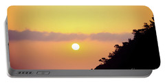 Portable Battery Charger featuring the photograph Orange Sunrise Above Sea by Raimond Klavins