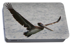 Portable Battery Charger featuring the photograph Pelican In Flight by Laurel Talabere
