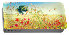 Portable Battery Charger featuring the photograph Poppies With Tree In The Distance by Silvia Ganora
