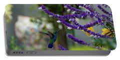 Portable Battery Charger featuring the photograph Purple Pleasure by John Kolenberg