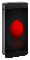 Red Egg On Black Canvas  Portable Battery Charger
