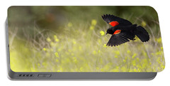 Red Winged Blackbird In Flight Portable Battery Charger