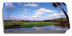 Reflection Of Clouds In A River, Myakka Portable Battery Charger by Panoramic Images