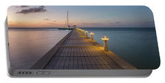 Portable Battery Charger featuring the photograph Rum Point Pier At Sunset by Adam Romanowicz
