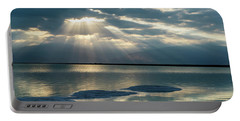 Portable Battery Charger featuring the photograph Sunrise At The Dead Sea by Arik Baltinester