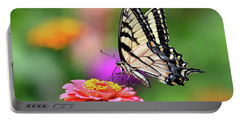 Portable Battery Charger featuring the photograph Swallowtail On A Zinnia by Rodney Campbell