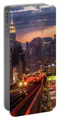 Portable Battery Charger featuring the photograph The City That Never Sleeps by Anthony Fields