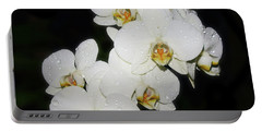 Portable Battery Charger featuring the photograph White Orchid by Elvira Ladocki
