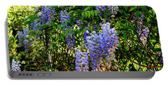 Portable Battery Charger featuring the photograph Wisteria by Betty-Anne McDonald
