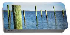 Portable Battery Charger featuring the photograph Wood Pilings by Colleen Kammerer