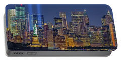 Portable Battery Charger featuring the photograph World Trade Center Wtc Tribute In Light Memorial II by Susan Candelario