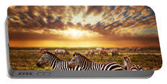 Zebras Herd On African Savanna At Sunset. Portable Battery Charger