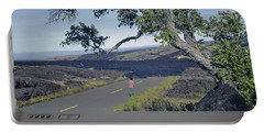 Portable Battery Charger featuring the photograph 100924 Lava Covered Road Hi by Ed Cooper Photography