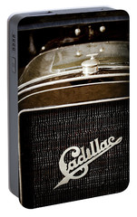 Portable Battery Charger featuring the photograph 1907 Cadillac Model M Touring Grille Emblem -1106ac by Jill Reger