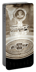 Portable Battery Charger featuring the photograph 1928 Chevrolet 2 Door Coupe Hood Ornament Moto Meter -0789s by Jill Reger