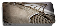 Portable Battery Charger featuring the photograph 1934 Desoto Airflow Coupe Hood Ornament -2404ac by Jill Reger
