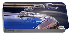 Portable Battery Charger featuring the digital art 1934  Ford Greyhound Hood Ornament by Chris Flees