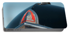 Portable Battery Charger featuring the photograph 1947 Plymouth Head Badge by Chris Flees