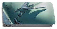 Portable Battery Charger featuring the photograph 1950s Chrysler Falcon Hood Ornament by Chris Flees