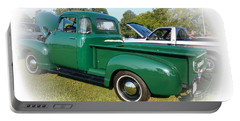Portable Battery Charger featuring the photograph 1952 Chevrolet by Geraldine DeBoer