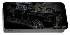 Portable Battery Charger featuring the photograph 1952 Neon Chevrolet Pickup by Geraldine DeBoer
